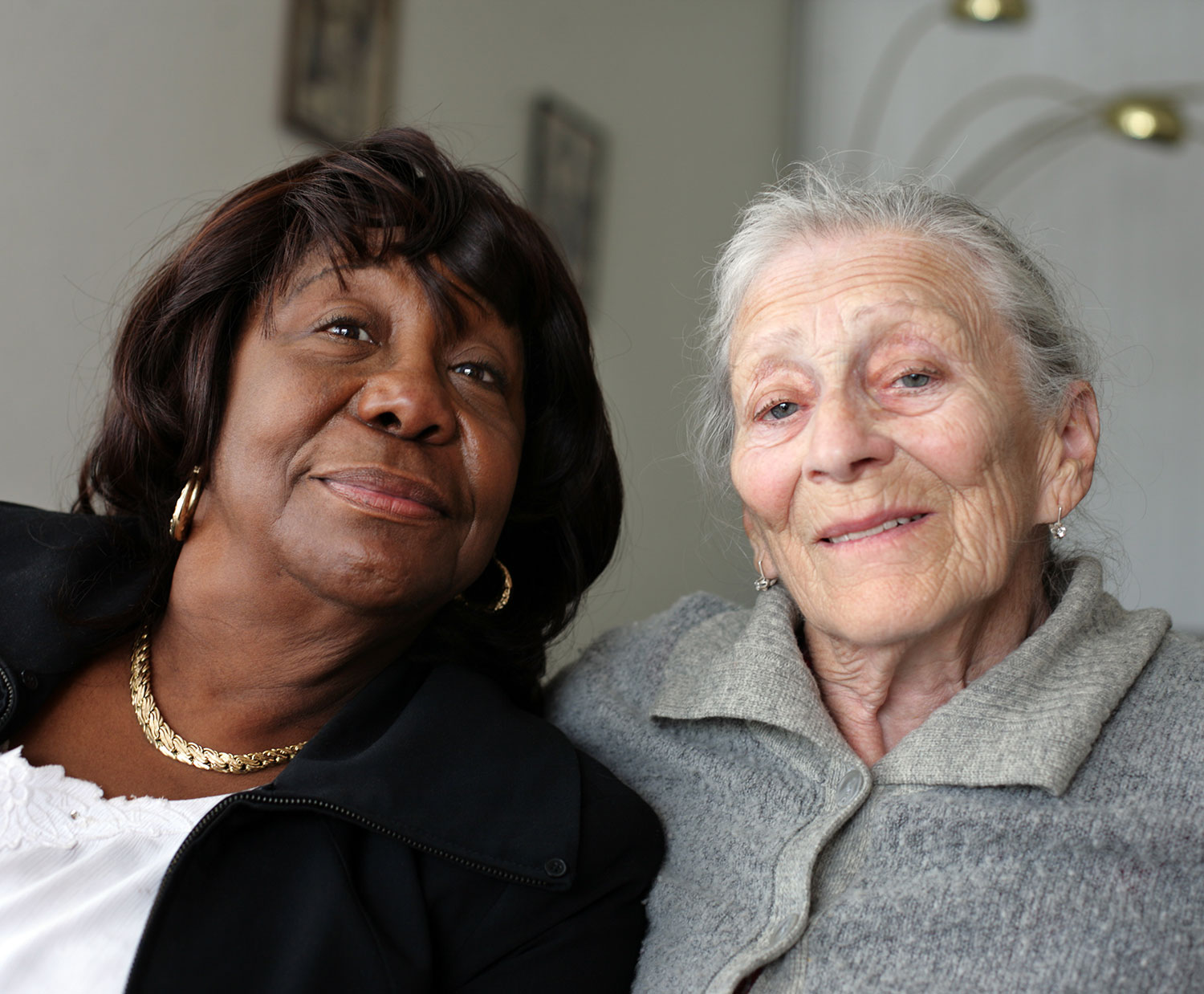 Afro woman with old woman